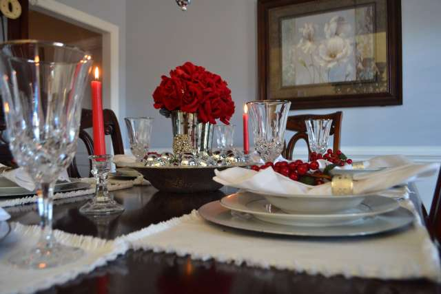 I love this beautiful tablescape with touches of red.