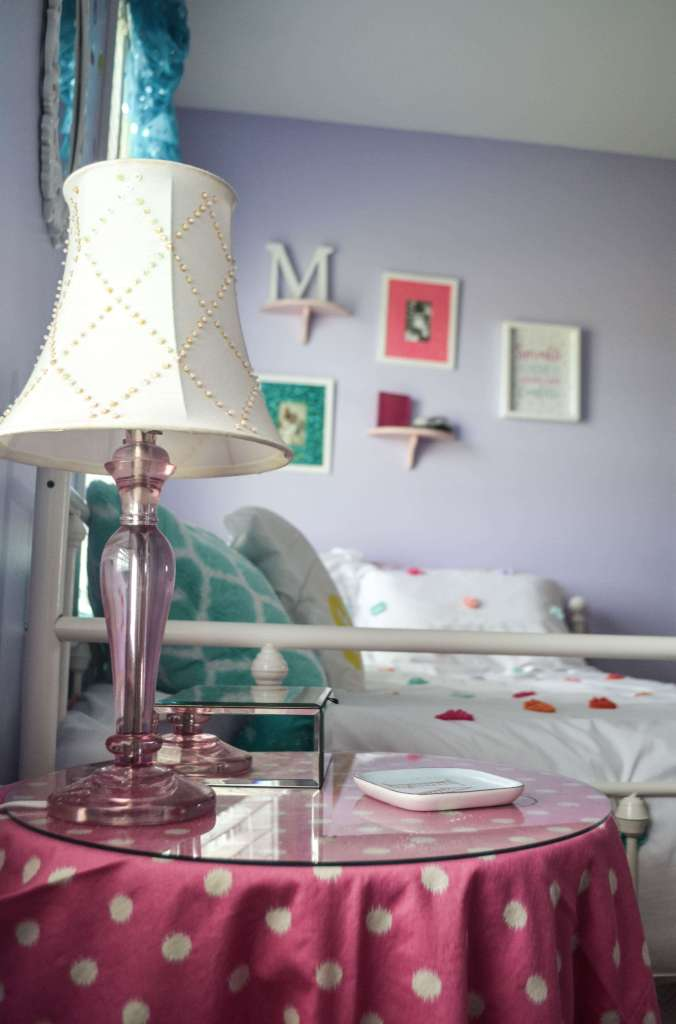 I love the pink and teal in this tween girl bedroom!