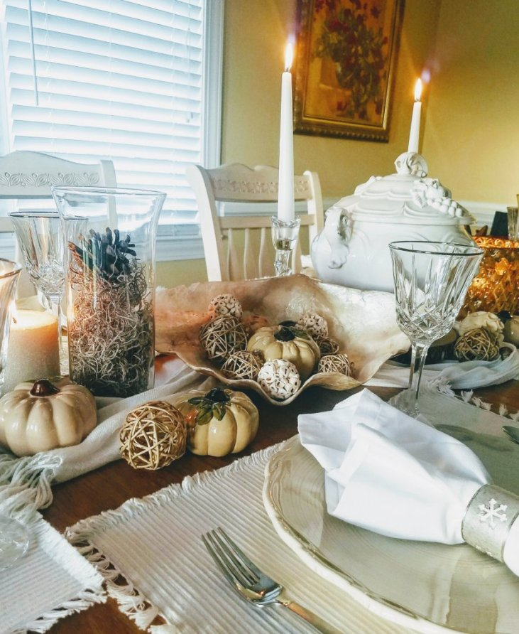 Love to decorate for fall without using red and orange? Try a white and gold tablescape!