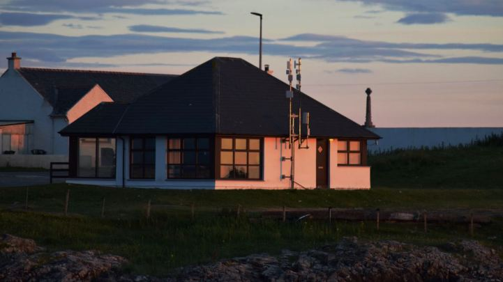 The Pier Office painted by the sunset