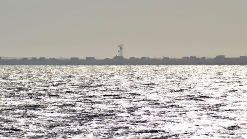 The BT Tower and an island in a silvery sea