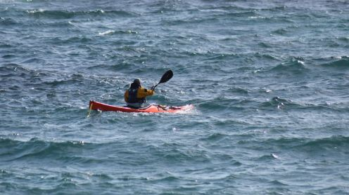 A Kayak heads out from the harbour
