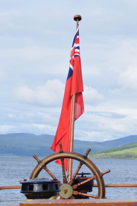 The stern of the Waverley - Flag and ship's wheel.