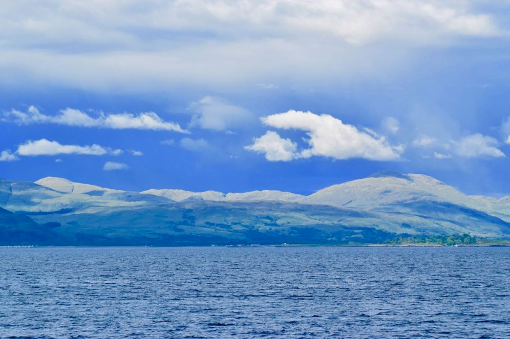Dramatic clouds in a sunny sky on the approach to Oban
