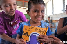 Giving out notebooks at Escuela La Rejega in southern Nicaragua with the San Juan del Sur Library