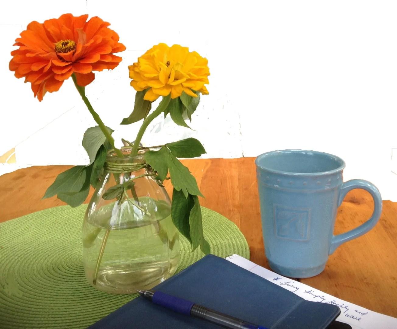 flowers in a b ottle, coffee, book