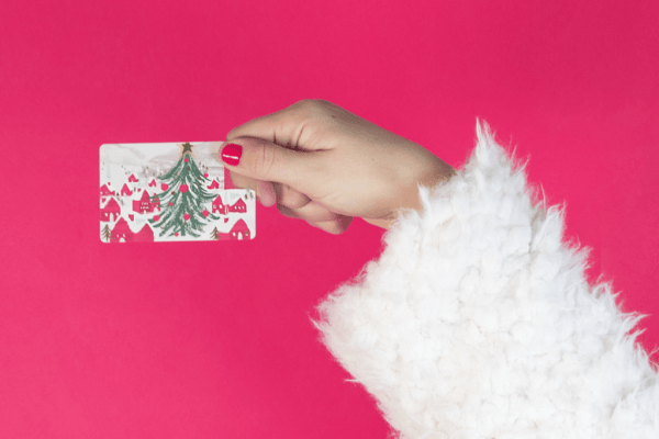 Woman holding a holiday gift card