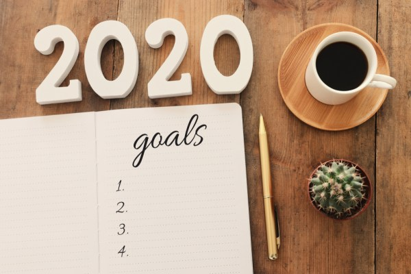 Notepad with goals for saving money in 2020