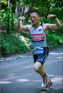 The face shows the amount of pain I was in at this point! Running my way to a 1st place AG win on the toughest 70.3 race on the Rev3 circuit.
