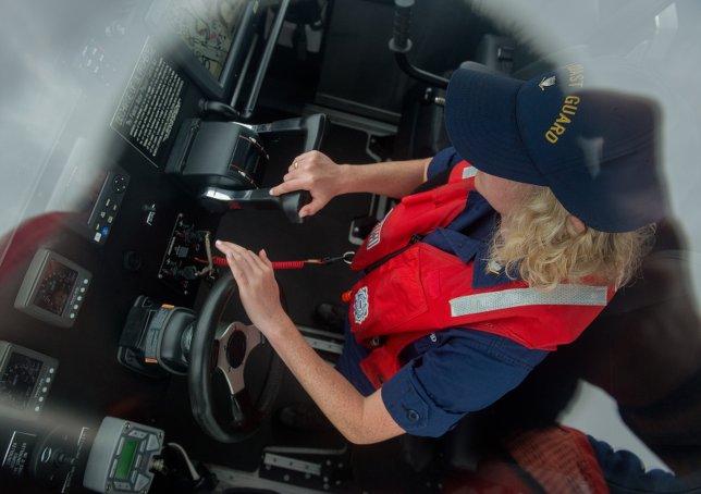 USCG Boat Driver maneuvers a vessel