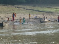 Villagers on the riverbank