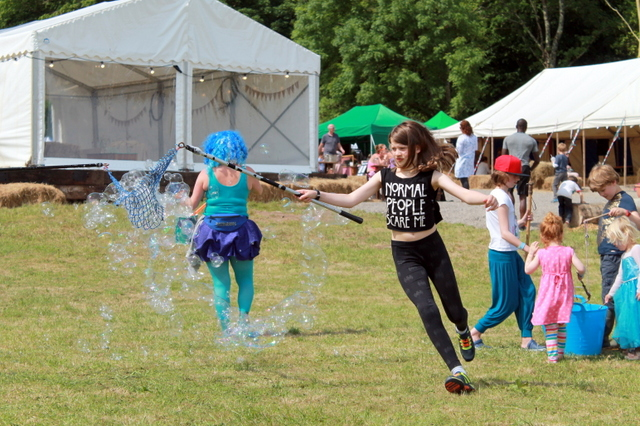 Kids playing with bubbles - The Big Retreat Wales