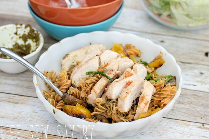Mix pasta and put chicken on top