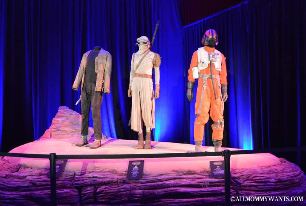 The costumes of Finn (John Boyega), Rey (Daisy Ridley), and Poe (Oscar Isaac).
