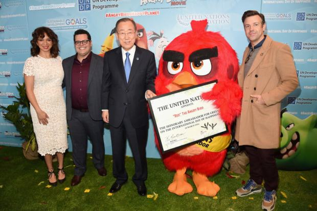 "NEW YORK, NY - MARCH 18: (L-R) Maya Rudolph, Josh Gad, Mr. Ban Ki-Moon, 'Red' and Jason Sudeikis attend the United Nations Ceremony, Presentation and Photo Call naming Red, from the ""ANGRY BIRDS movie, Honorary Ambassador for the International Day of Happiness, to be observed around the world on March 20th, at United Nations on March 18, 2016 in New York City."