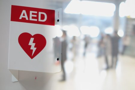Aed,Automated,External,Defibrillator,Sign,At,An,Airport.,Double,Exposure