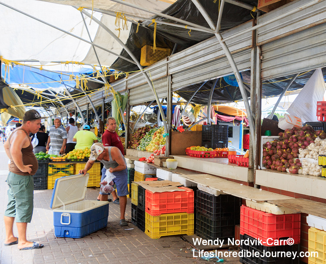 The floating market at the colourful UNESCO World Heritage Site of Willemstad on the Caribbean Island of Curaçao. The waterfront market at the UNESCO World Heritage Site of Willemstad on the Caribbean Island of Curaçao. Photo Credit: Wendy Nordvik-Carr