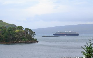 Holland America's Zuiderdam arrives at Portree. The Scottish town of Portree is a port of call for many cruise ships and a great place to start your discovery of the rugged countryside of Isle of Skye. Photo Credit Wendy Nordvik-Carr