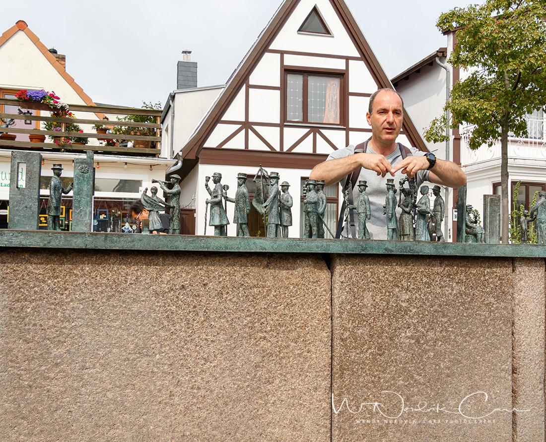 "The SPB Tour guide describes the cast bronze Warnemünde fountain sculpture ""Warnminner Ümgang"" was created n 2004 by Wolfgang Friedrich. Photo Credit: Wendy Nordvik-Carr"