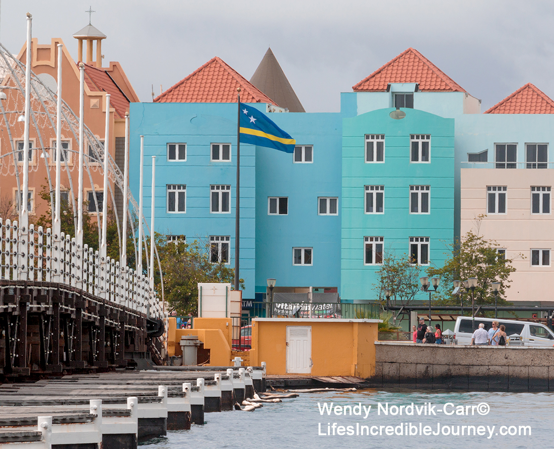 Colourful UNESCO World Heritage Site of Willemstad on the Caribbean Island of Curaçao. The waterfront market at the UNESCO World Heritage Site of Willemstad on the Caribbean Island of Curaçao. Photo Credit: Wendy Nordvik-Carr