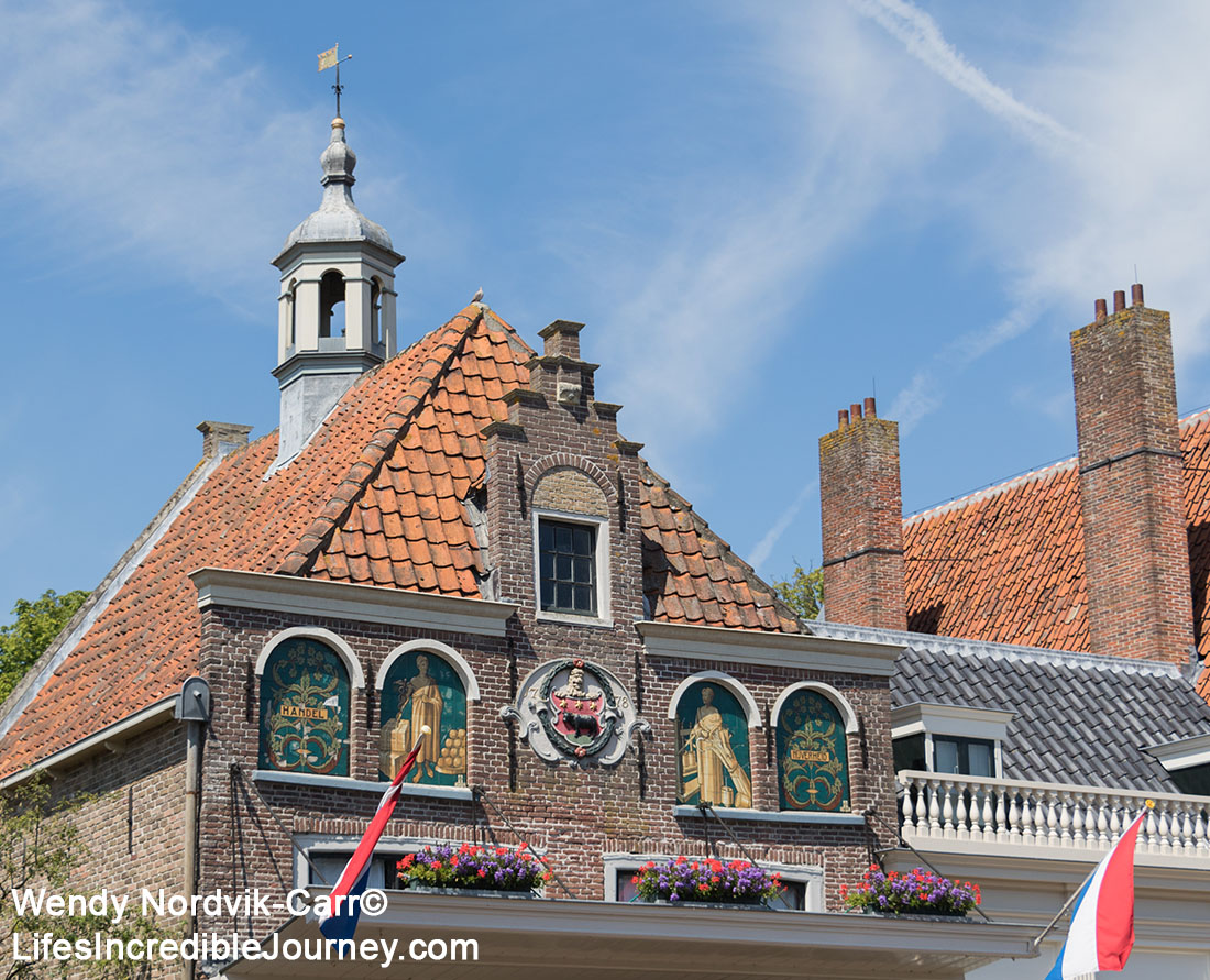 The Cheese Weigh House - The picturesque town of Edam has 17th century architecture along its historic streets and canals. Once a shipbuilding town, Edam is world famous for its cheese. Edam is located in northern Dutch countryside near Amsterdam. Photo Credit: Wendy Nordvik-Carr©
