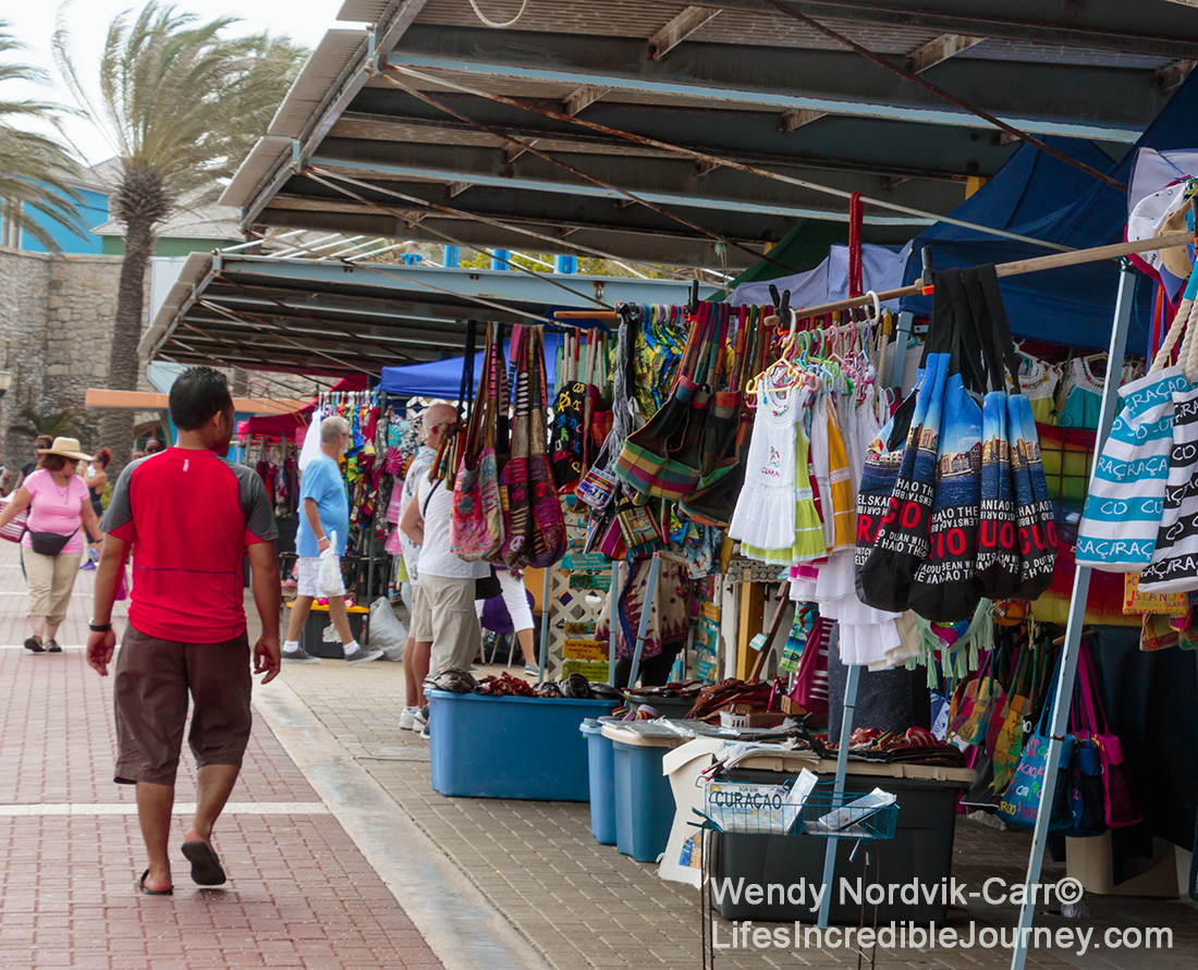 The waterfront market at the UNESCO World Heritage Site of Willemstad on the Caribbean Island of Curaçao. Photo Credit: Wendy Nordvik-Carr