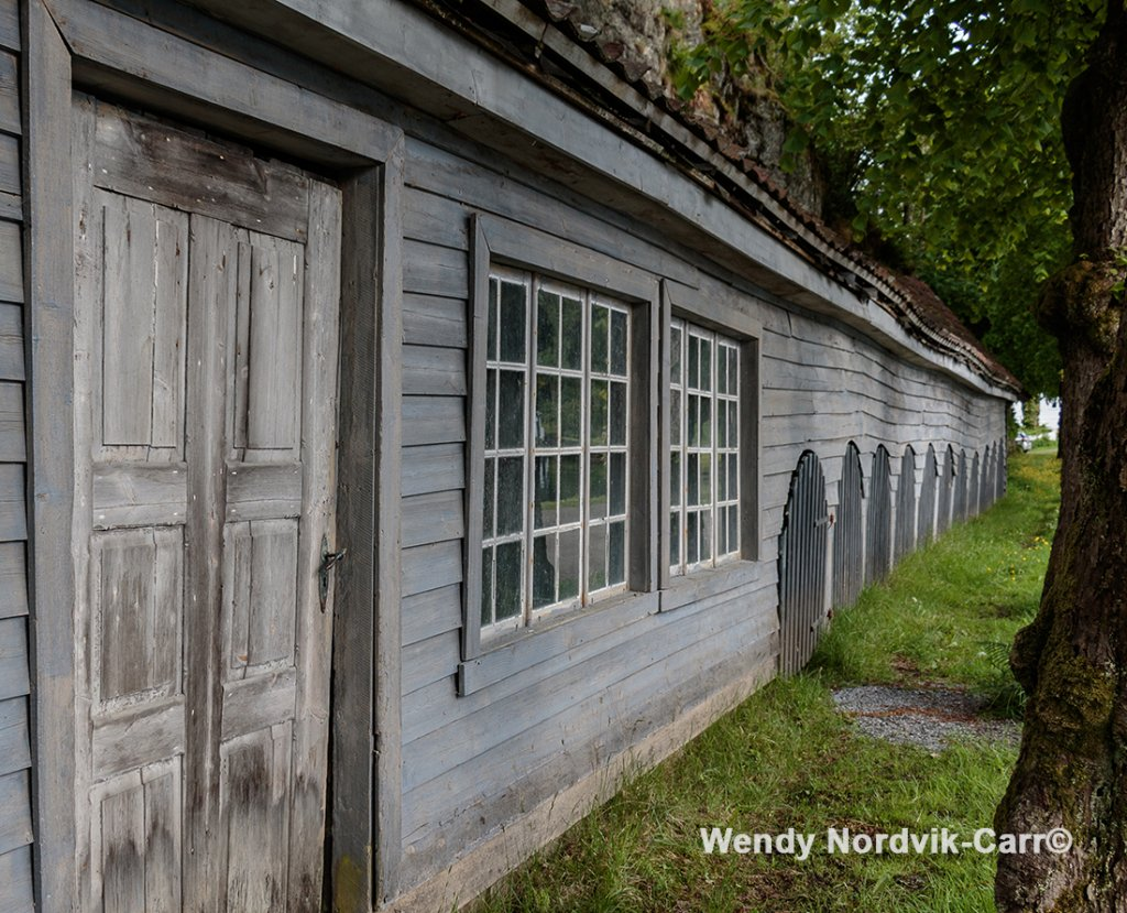 Historic outer buildings at Norway's oldest industrial community Alvøen museum near Bergen.