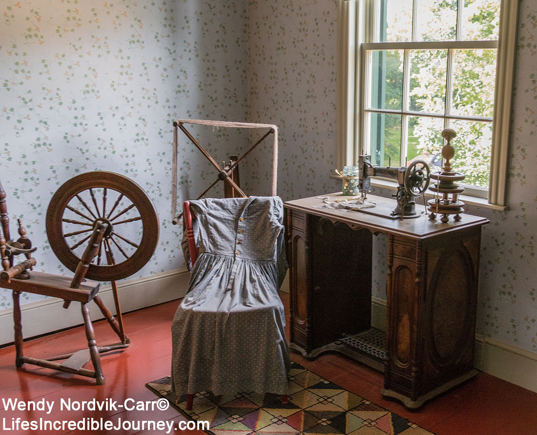 "19th century sewing room inside PEI Green Gables Heritage. Green Gables stunning countryside setting is located in Prince Edward Island National Park in Cavendish. Cavendish and the 19th century farm, Haunted Woods and Lover's Lane were made famous by author Lucy Maud Montgomery with her stories about ""Anne of Green Gables"". Don't miss this popular tourist destination on the scenic drive known as Green Gable Shore. Photo: Credit: Wendy Nordvik-Carr©"