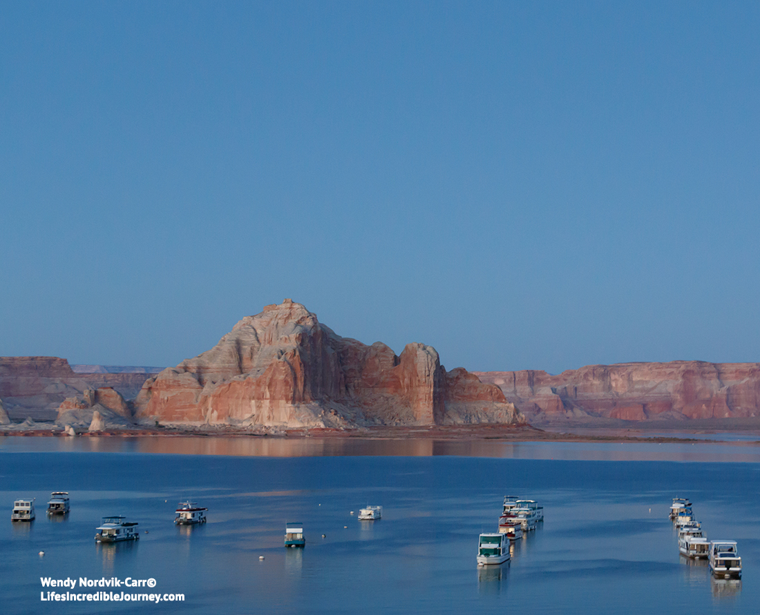 Houseboating on Lake Powell is one of the top things to do at Lake Powell. Houseboat rentals on Lake Powell. Photo Credit: Wendy Nordvik-Carr