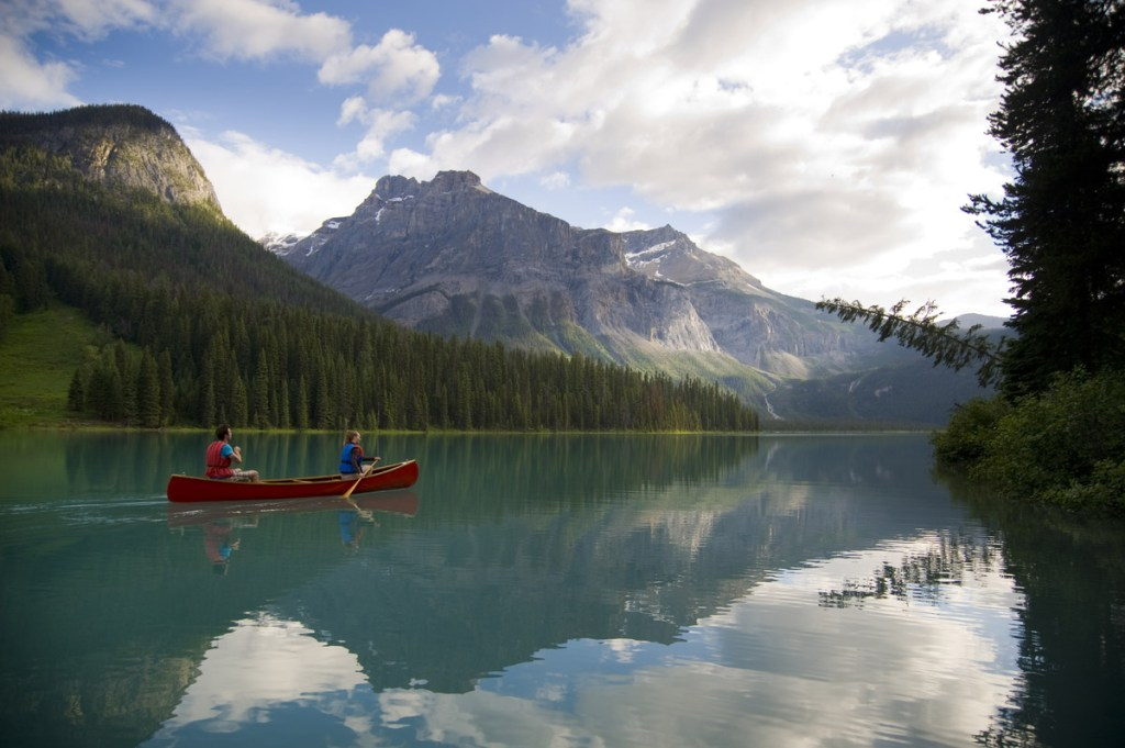 Emerald Lake with views of the mountains in Yoho National Park near Field. Photo Credit: Destination BC/Dave Heath