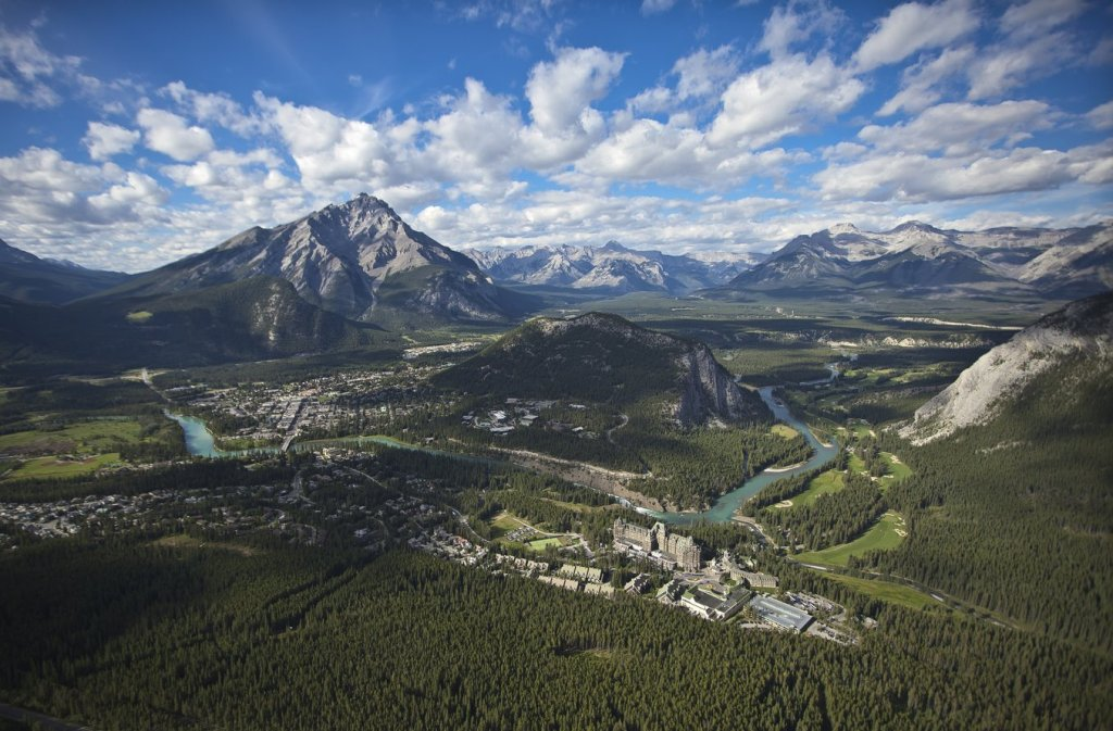Spectacular things to do at Lake Louise Banff. Above Banff National Park Aerial Banff Townsite. Photo Credit: Travel Alberta, Paul Zizka©