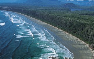 One of the top things to do on Vancouver Island is visit the wild west coast of Vancouver Island. This is an aerial view of Long Beach in Pacific Rim National Park Reserve near Tofino. Photo Credit Destination British Columbia