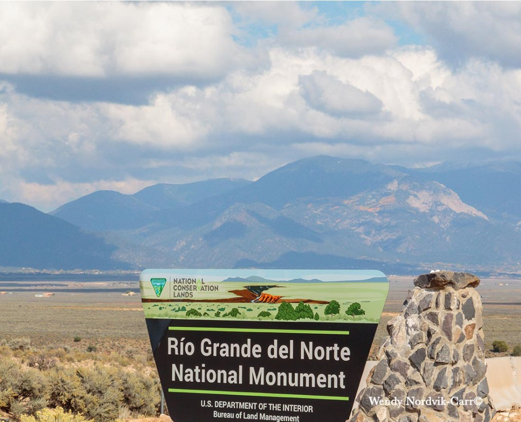 The Rio Grande del Norte National Monument is one of the top things to see on a road trip from Taos to Santa Fe New Mexico. It boasts unique geological land formations. Photo: Wendy Nordvik-Carr©