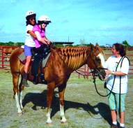 Mimi on a horse