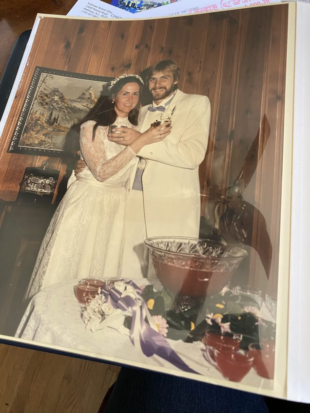 bride and groom pic in old album with yellow sleeve