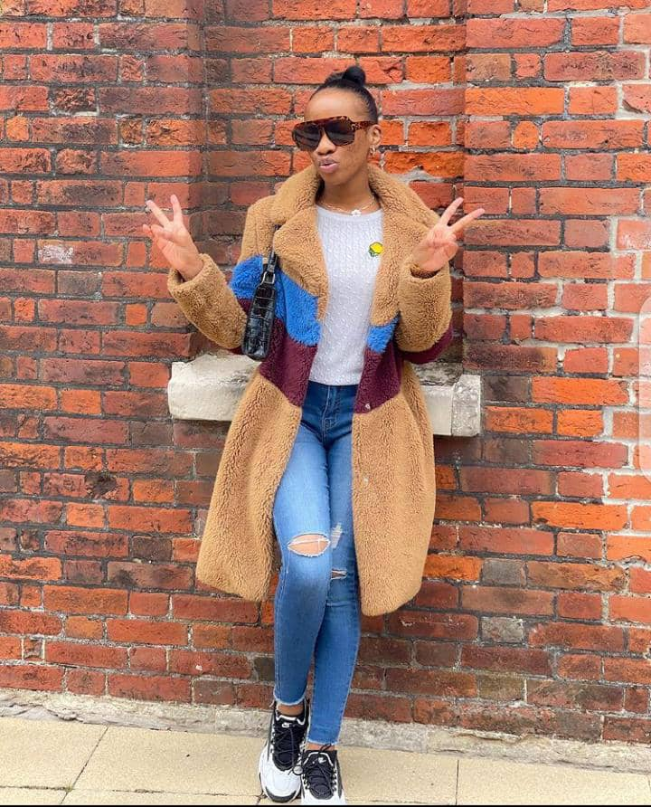 lady wearing layering over jeans and white tees