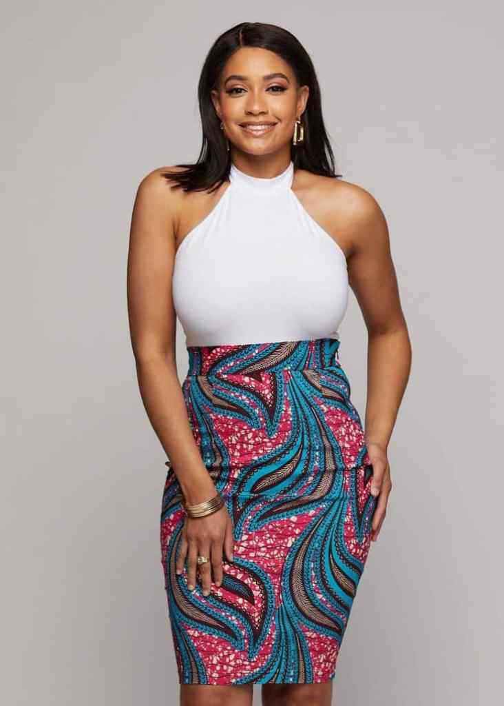 lady wearing straight ankara pencil skirt with white top
