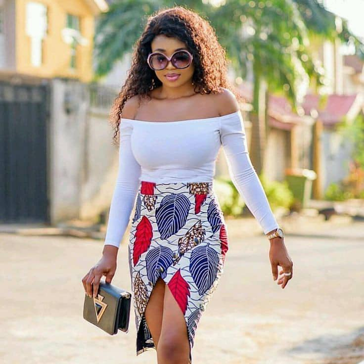 lady looking stylish in white top and tulip ankara skirt