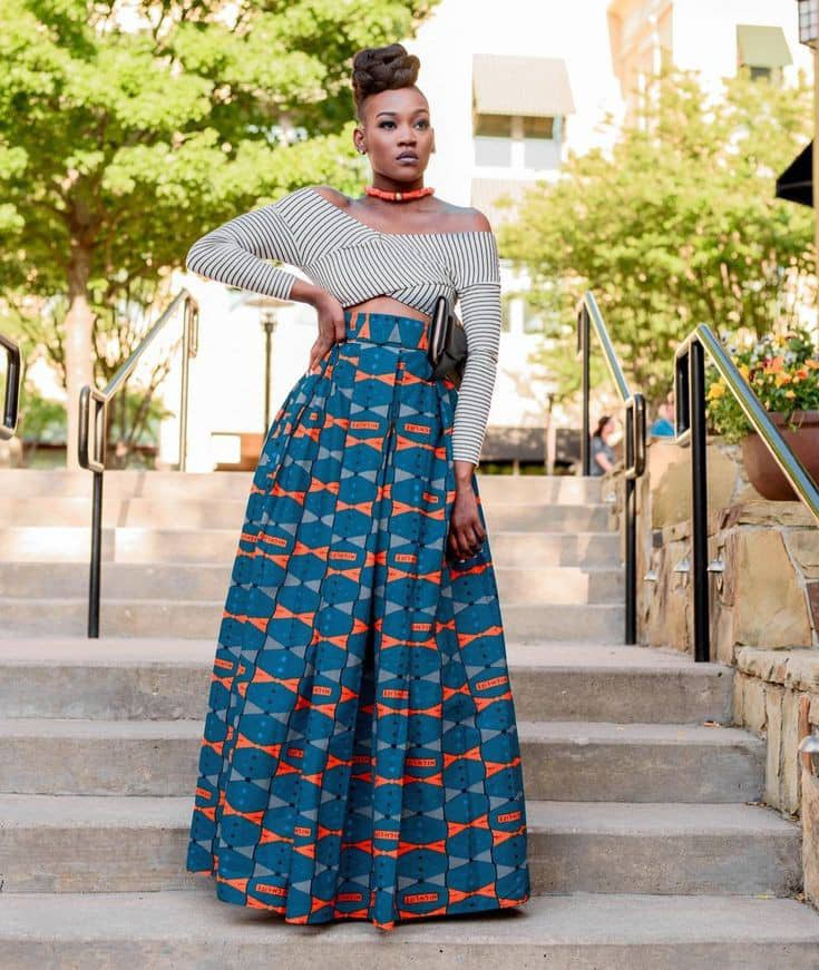 lady wearing white top with ankara maxi skirt
