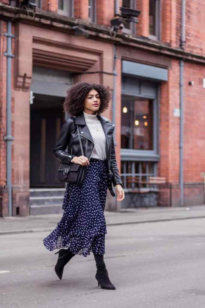lady wearing polka dots skirt with jacket