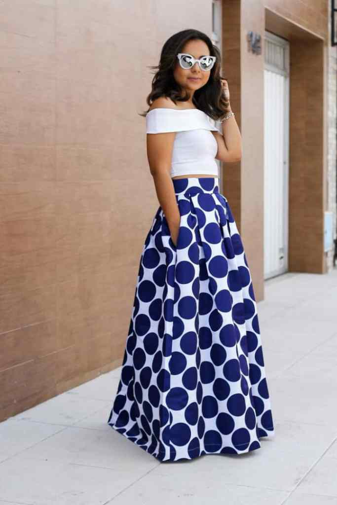 lady wearing polka dots maxi skirt with white plain top