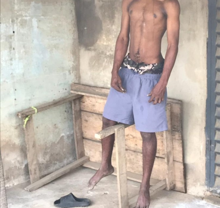 Man found hanged beside a police station in Okota (video/photos)