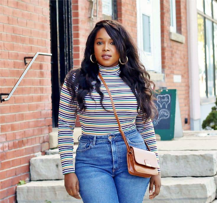 lady wearing turtleneck with jeans
