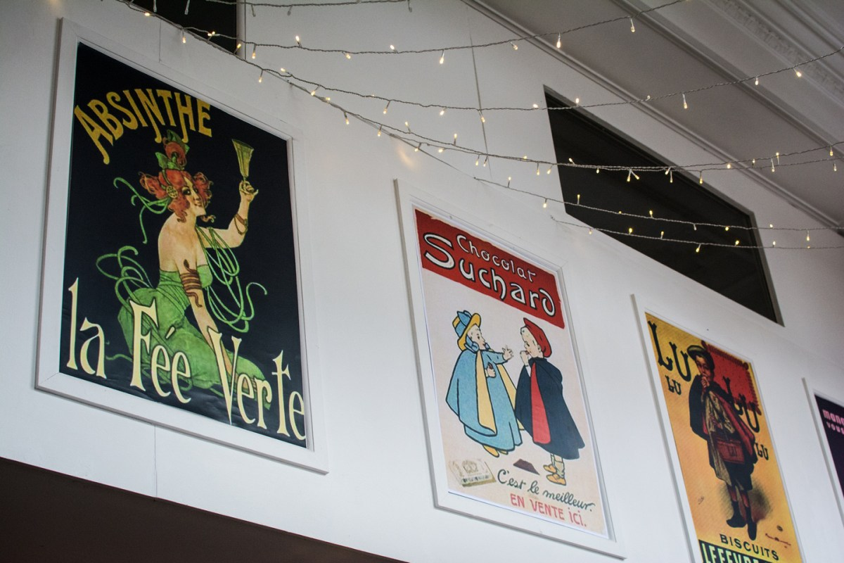 Traditional posters at La Guinguette restaurant in Bristol