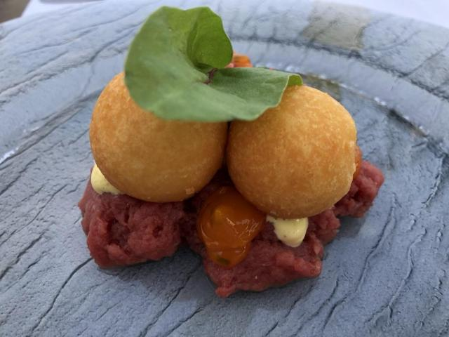 Deep fried cheese balls on beef tartare