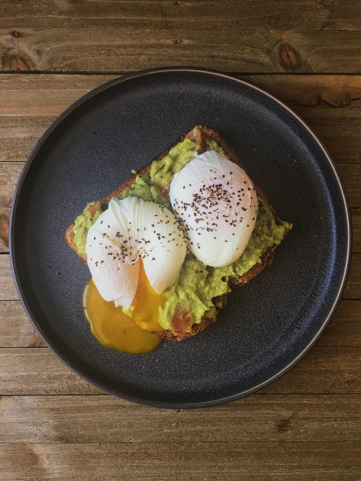 Beautifully poached egg on avocado toast