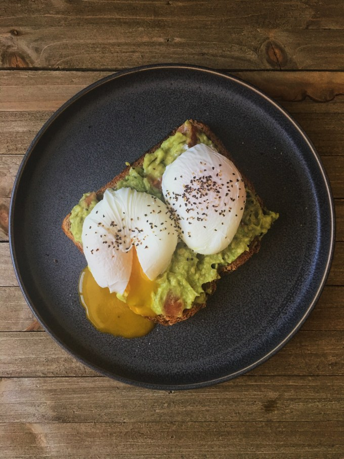 Beautifully poached egg on avocado toast