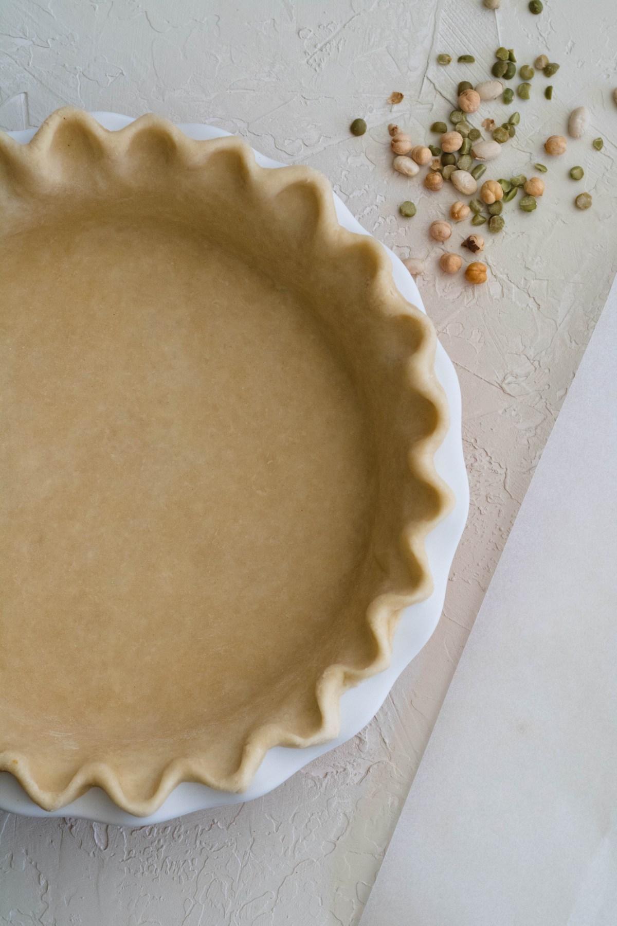 Raw pie crust before baking