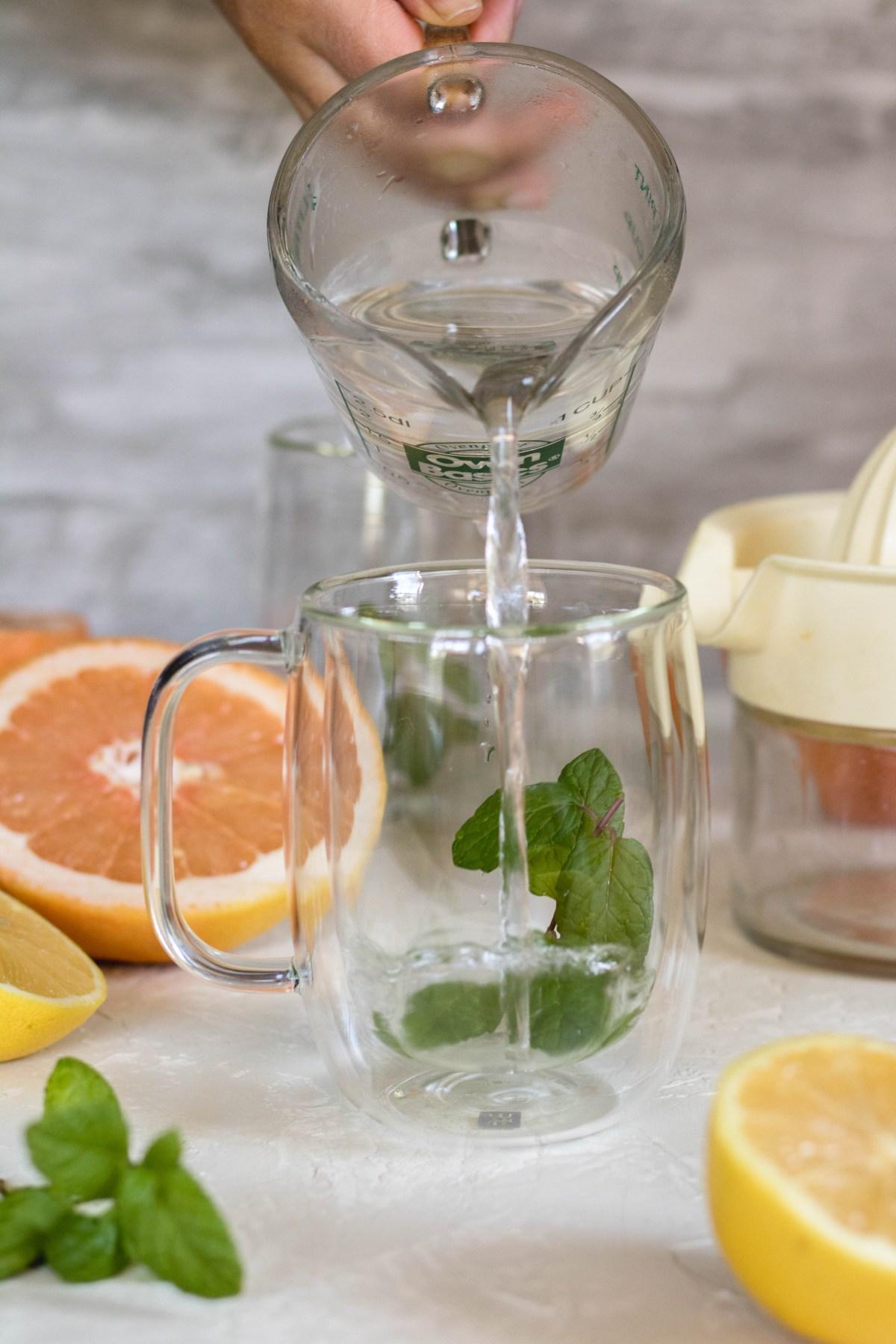 Making mint tea for detox grapefruit tea