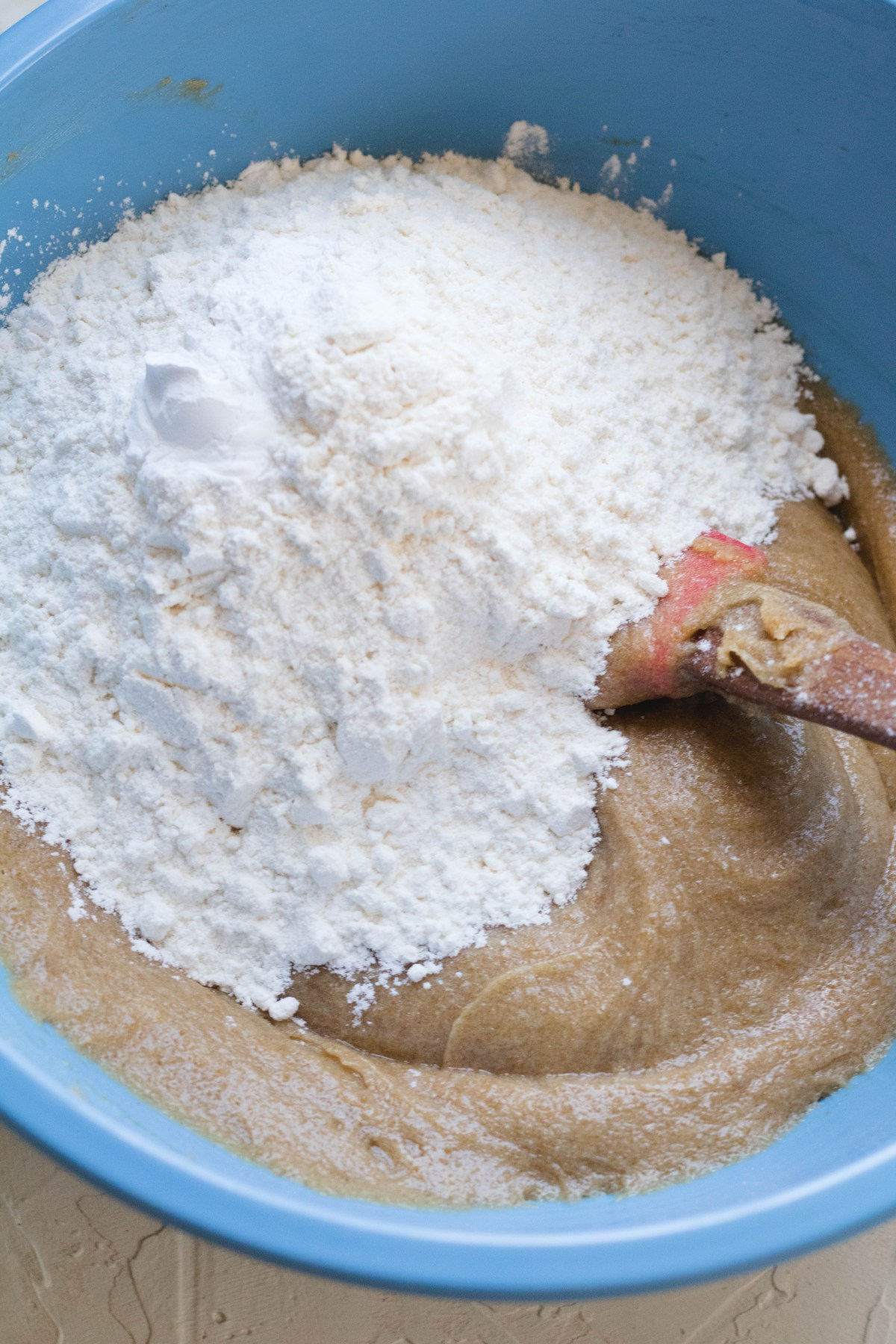 adding flour to blondies mix